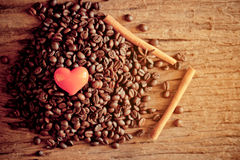 Red heart on coffee bean Stock Photo