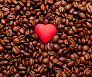 Red heart on coffee beans Royalty Free Stock Photo