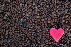 Red heart on coffee beans Stock Image