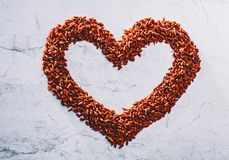 Red heart composed of little goji berries. Royalty Free Stock Photos