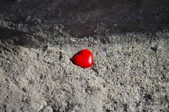 Red heart on concrete background royalty free stock photography