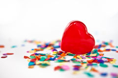 Red heart with confetti Royalty Free Stock Photo