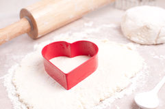 Red heart cookie cutter and rolling pin Royalty Free Stock Photography