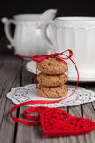 Red heart and cookies on wooden background Stock Photos