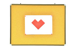 Red heart on cork board Stock Images