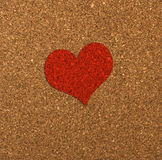 Red heart on a cork board. Stock Photos
