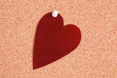Red heart on corkboard Stock Image