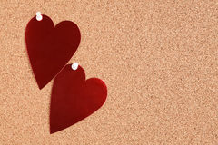 Red heart on corkboard Stock Photos