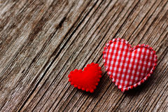 Red heart couple on wooden background. Stock Photos