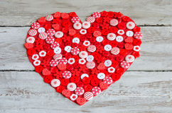Red heart covered with colorful buttons. Stock Photo