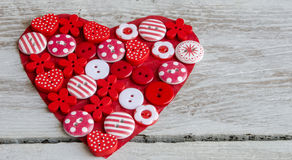 Red heart covered with colorful buttons. Stock Image