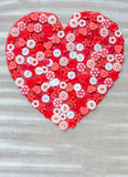 Red heart covered with colorful buttons. Stock Photography