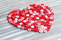 Red heart covered with colorful buttons. Royalty Free Stock Photography