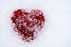 Red Heart Covered in Snow Stock Photography