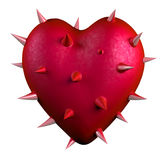 Red heart covered by thorns Stock Image