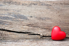 Red heart in crack of wooden plank Royalty Free Stock Images