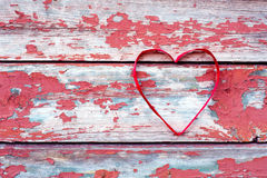 Red heart at cracked boards Royalty Free Stock Image