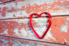 Red heart at cracked boards Royalty Free Stock Photo