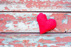 Red heart at cracked planks Stock Photography