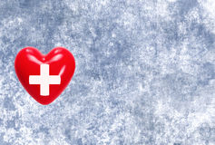 Red heart with cross sign on grunge texture background Royalty Free Stock Image