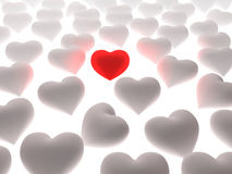 Red heart in a crowd of white hearts. On white background. Three dimensional illustration Stock Image