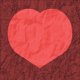 Red heart from crumpled paper on a burgundy background Royalty Free Stock Photos