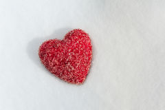 A red Heart lying on Snow Stock Image