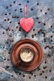 Red heart and cup of coffee on a dark rustic abstract background. Valentine`s Day. Top view, vertical frame.  royalty free stock image