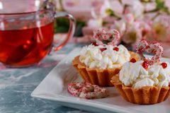 Red heart cupcakes with decorations for Valentines day. Red heart sweet cupcakes with decorations for Valentines day royalty free stock photography