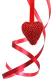 Red heart and curly ribbon Royalty Free Stock Photography