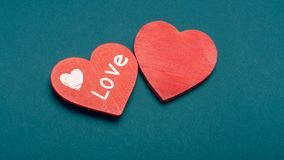 Red heart on a dark paper background. The concept of Valentine`s Day, the day of love, mother`s day. Copy space background textu stock images
