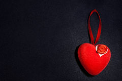 Red heart on the dark Stock Photos