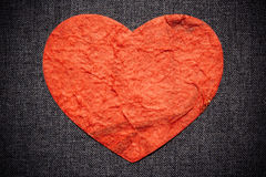 Red heart on a dark wall, valentine background Royalty Free Stock Images