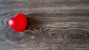 Red heart. On a dark wooden background Stock Photography