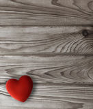 Red heart on dark wooden planks Stock Image