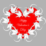 A red heart decorated with flying white doves and smaller hearts Stock Photo