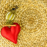 Red heart decoration on background made of dry banana leaf Royalty Free Stock Photo