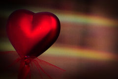 Red heart on defocoused background Stock Photo