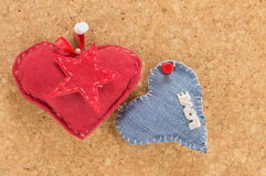 Red heart and denim heart Stock Photos