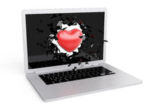 Red Heart destroy laptop Royalty Free Stock Image