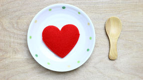 Red heart in dish Royalty Free Stock Images