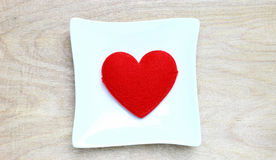 Red heart in dish Royalty Free Stock Image