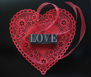Red heart doily with love on black Stock Photo