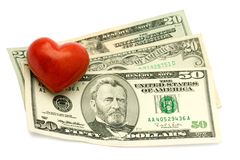 Red Heart on dollar Stock Photography