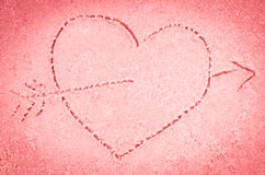 Red heart drawing on sand Royalty Free Stock Images