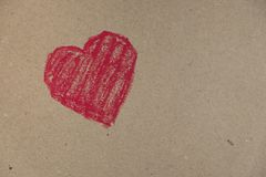 Red heart drawn on a cardboard background royalty free stock photos