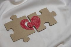 Red heart is drawn on pieces of a puzzle lying at a distance Royalty Free Stock Photo