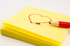 Red heart drawn on a Post-it Royalty Free Stock Photos