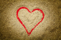 Red heart drawn in the sand Royalty Free Stock Images