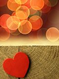 Red heart on the edge of a wooden table Stock Image